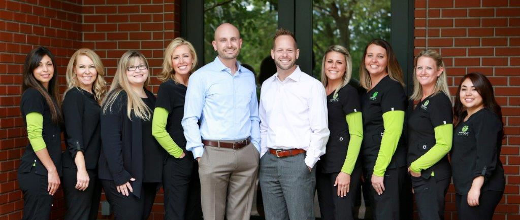 Dr. Simon Yakligian & Dr. Michael Umberger with Harmony Dental staff.