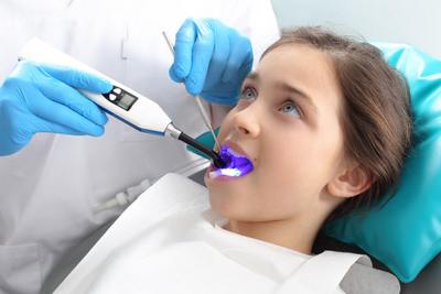 Young girl receiving selant treatment  at Harmony Dental, Eugene, OR